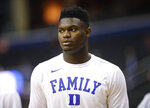 FILE - In this March 31, 2019, file photo, Duke forward Zion Williamson warms up before the start of an NCAA men's East Regional final college basketball game against Michigan State, in Washington. The player widely projected to be the NBA draft's top overall pick came up at a college basketball corruption trial as jurors heard a recording of a Clemson coach who seemed eager for help recruiting him. The charismatic Zion Williamson played one year at Duke before entering the draft scheduled for June. (AP Photo/Patrick Semansky, File)