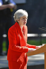Britain's Prime Minister Theresa May makes a statement outside at 10 Downing Street in London, Friday May 24, 2019. Theresa May says she'll quit as UK Conservative leader on June 7, sparking contest for Britain's next prime minister. (Dominic Lipinski/PA via AP)