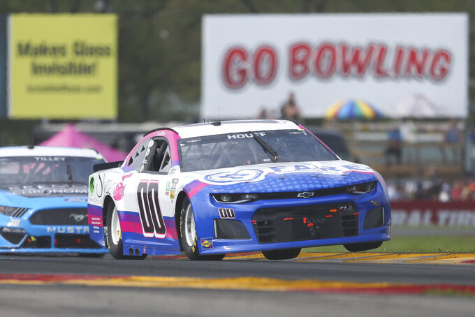 Quin Houff drives through the Bus Stop during a NASCAR Cup Series auto race in Watkins Glen, N.Y., on Sunday, Aug. 8, 2021. (AP Photo/Joshua Bessex)