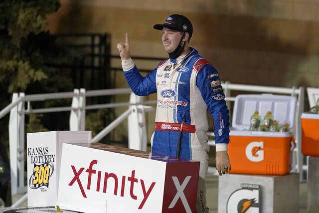FILE - Chase Briscoe celebrates in victory lane following a NASCAR Xfinity Series auto race at Kansas Speedway in Kansas City, Kan., Saturday, Oct. 17, 2020.  Briscoe professionally has had the best season of his career with nine wins, a promotion next year to the Cup Series and the chance to cap it with the Xfinity Series championship. The on-track success in this once-in-a-lifetime season has been the public side of an emotionally heartbreaking personal journey.  (AP Photo/Orlin Wagner, File)