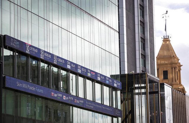 The New Zealand Stock Exchange board is shown on the side of Jarden Building in central Auckland, New Zealand, Friday, Aug. 28, 2020. New Zealand's government and overseas spy agency are getting involved after ongoing cyber attacks have disrupted the New Zealand stock exchange several times this week. (Greg Bowker/New Zealand Herald via AP)