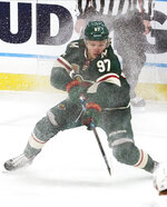 Minnesota Wild's Kirill Kaprizov shaves off the ice during the first period of the team's NHL hockey game against the San Jose Sharks, Friday, Jan. 22, 2021, in St. Paul, Minn. (AP Photo/Jim Mone)