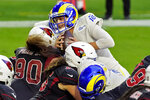 Los Angeles Rams quarterback Jared Goff (16) scores a touchdown against the Arizona Cardinals during the second half of an NFL football game, Sunday, Dec. 6, 2020, in Glendale, Ariz. (AP Photo/Rick Scuteri)
