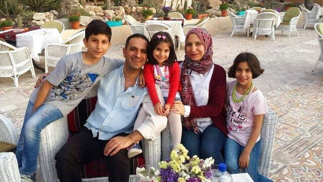 This undated 2018 photo shows Dr. Mohammed Ayesh and his family in Gaza. Ayesh is among several Gazans who are unable to return to the territory because of a dispute between Israel and the Palestinian Authority. The PA stopped coordinating travel permits with Israel when it cut off all contacts in May 2020 to protest Israel's plans to annex up to 30% of the occupied West Bank. (Ayesh family via AP)