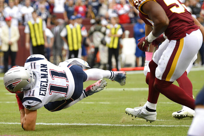 New England Patriots wide receiver Julian Edelman (11) falls into the end zone for a touchdown against the Washington Redskins during the first half of an NFL football game, Sunday, Oct. 6, 2019, in Washington. (AP Photo/Nick Wass)