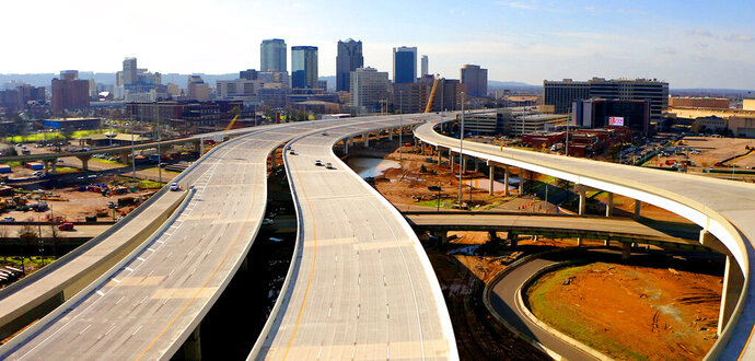 The new Interstate 59/20 in Birmingham, Ala., is shown in this aerial photo made with a drone on Thursday, Jan. 16, 2020. Officials say a new, mile-long section of highway is opening after a yearlong shutdown that forced drivers to take city streets or a perimeter highway to travel through Alabama's largest city. (Joe Songer/The Birmingham News via AP)
