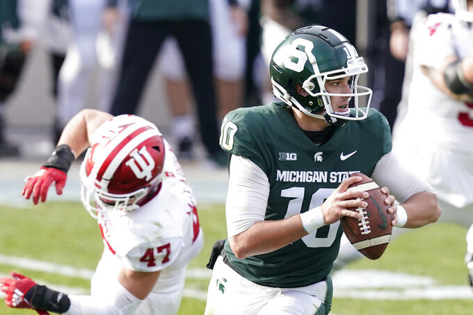 Michigan State quarterback Payton Thorne scrambles during the second half of an NCAA college football game against Indiana, Saturday, Nov. 14, 2020, in East Lansing, Mich. (AP Photo/Carlos Osorio)