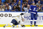 Buffalo Sabres center Johan Larsson (22), of Sweden, holds Tampa Bay Lightning center Yanni Gourde's stick after he was knocked down by Gourde during the second period of an NHL hockey game Thursday, Feb. 21, 2019, in Tampa, Fla. (AP Photo/Chris O'Meara)