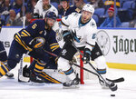 Buffalo Sabres defenseman Marco Scandella (6) defends against San Jose Sharks forward Barclay Goodrow (23) during the second period of an NHL hockey game Tuesday, Oct. 22, 2019, in Buffalo, N.Y. (AP Photo/Jeffrey T. Barnes)