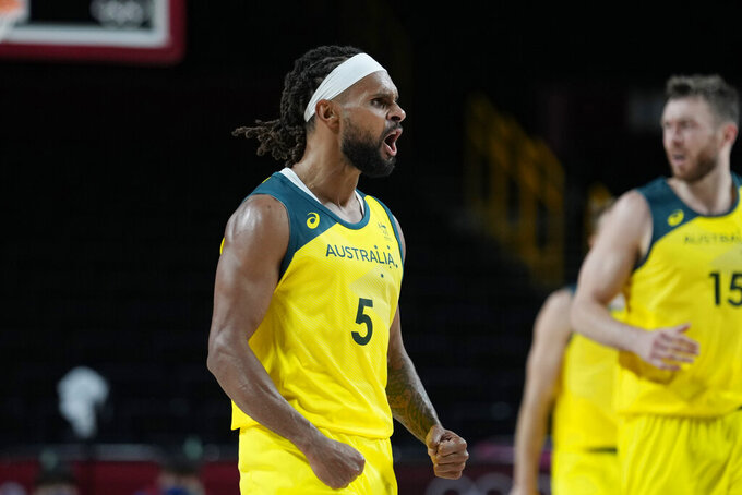 Australia's Patty Mills (5) celebrates after a score against Germany during a men's basketball preliminary round game at the 2020 Summer Olympics, Saturday, July 31, 2021, in Saitama, Japan. (AP Photo/Eric Gay)