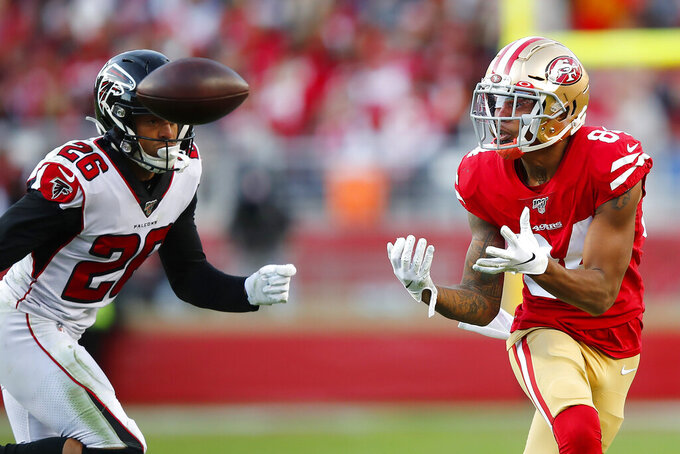 San Francisco 49ers wide receiver Kendrick Bourne, right, catches a pass against Atlanta Falcons cornerback Isaiah Oliver (26) during the second half of an NFL football game in Santa Clara, Calif., Sunday, Dec. 15, 2019. (AP Photo/John Hefti)