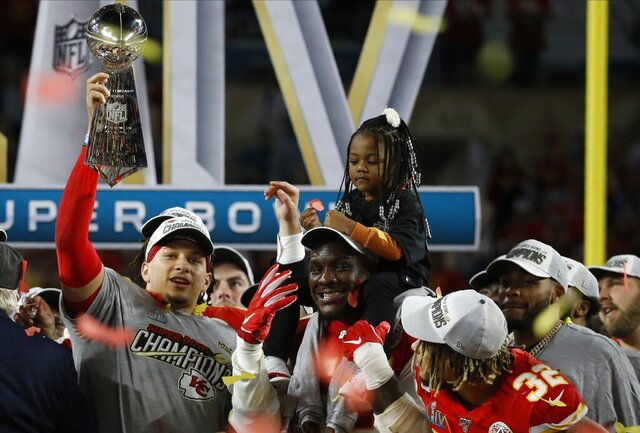 Kansas City Chiefs quarterback and MVP Patrick Mahomes celebrates with Frank Clark and Tyrann Mathieu (32) after the NFL Super Bowl 54 football game against the San Francisco 49ers Sunday, Feb. 2, 2020, in Miami Gardens, Fla. The Kansas City Chiefs won 31-20. (AP Photo/Mark Humphrey)