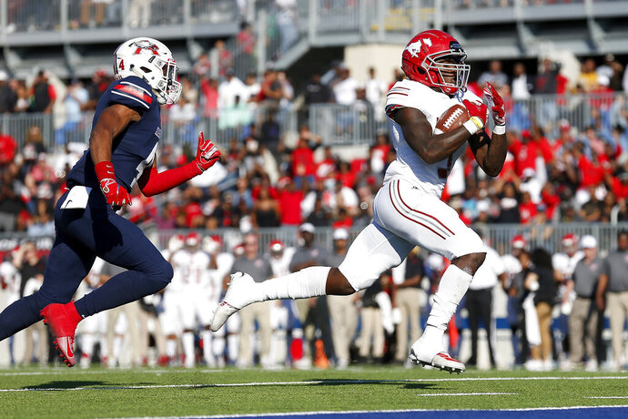 FILE - In this Dec. 7, 2019, file photo, North Shore Mustangs running back Zachary Evans (3) rushes for a touchdown chased by Atascocita Eagles Daniel Onwuachi (4) during the first half of the high school football playoff game at Sheldon ISD Panther Stadium in Houston, Texas. Evans reportedly signed with Georgia but got released from his letter of intent and was connected to a few different schools before eventually becoming the first five-star recruit ever to sign with TCU. Evans rushed for nearly 5,000 career yards at North Shore High in Houston and was the nation's No. 16 overall recruit according to the 247Sports Composite. (Tim Warner/Houston Chronicle via AP, File)