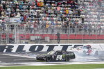 NASCAR Xfinity Series driver Ty Gibbs (54) and Brandon Brown (68) crash at the end of the NASCAR Xfinity auto race at the Charlotte Motor Speedway Saturday, Oct. 9, 2021, in Concord, N.C. (AP Photo/Matt Kelley)