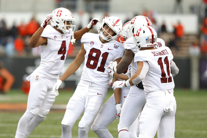 Stanford wide receiver Brycen Tremayne (81) is congratulated by teammates after scoring a touchdown off a pass from quarterback Davis Mills (15) during the second half of an NCAA college football game against Oregon State in Corvallis, Ore., Saturday, Sept. 28, 2019. (AP Photo/Amanda Loman)