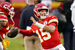 Kansas City Chiefs quarterback Patrick Mahomes (15) warms up before an NFL football game between the Chiefs and the Houston Texans Thursday, Sept. 10, 2020, in Kansas City, Mo. (AP Photo/Charlie Riedel)