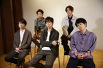 Members of Japanese pop music band ARASHI listen to a question during an interview with The Associated Press in Tokyo on Thursday, Sept. 17, 2020. Back row, from left, clockwise, are Satoshi Ohno, Masaki Aiba, Kazunari Ninomiya, Jun Matsumoto and Sho Sakurai. The Japanese pop sensation group has a big surprise for fans as they near their planned hiatus at year's end: a collaboration with Bruno Mars on their first all-English single. (AP Photo/Hiro Komae)