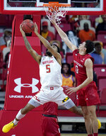 Maryland guard Eric Ayala (5) goes up for a shot against Rutgers guard Geo Baker during the first half of an NCAA college basketball game, Monday, Dec. 14, 2020, in College Park, Md. (AP Photo/Julio Cortez)