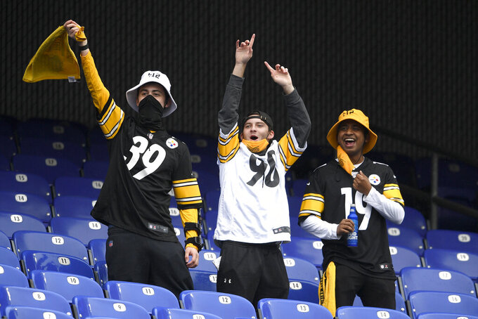 Spectators react prior to an NFL football game between the Baltimore Ravens and the Pittsburgh Steelers, Sunday, Nov. 1, 2020, in Baltimore. (AP Photo/Nick Wass)