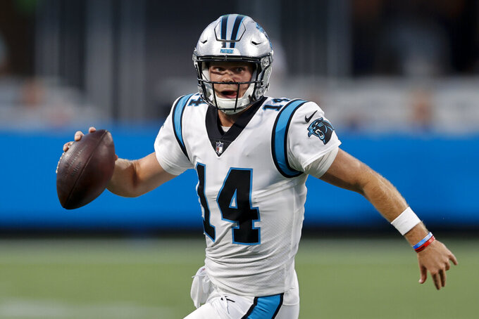 Carolina Panthers quarterback Sam Darnold looks to pass during the first half of a preseason NFL football game against the Pittsburgh Steelers Friday, Aug. 27, 2021, in Charlotte, N.C. (AP Photo/Nell Redmond)