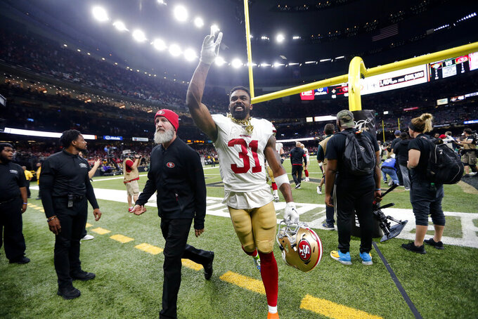 San Francisco 49ers running back Raheem Mostert (31) celebrates after an NFL football game against the New Orleans Saints in New Orleans, Sunday, Dec. 8, 2019. The 49ers won 48-46. (AP Photo/Brett Duke)