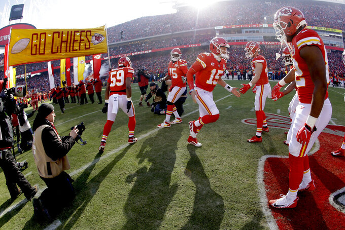 Kansas City Chiefs' Patrick Mahomes (15) is introduced before the NFL AFC Championship football game against the Tennessee Titans Sunday, Jan. 19, 2020, in Kansas City, MO. (AP Photo/Charlie Riedel)