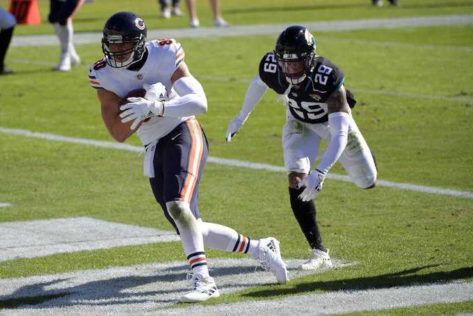 Chicago Bears tight end Jimmy Graham, left, catches a pass for a touchdown in front of Jacksonville Jaguars safety Josh Jones (29) during the first half of an NFL football game, Sunday, Dec. 27, 2020, in Jacksonville, Fla. (AP Photo/Phelan M. Ebenhack)