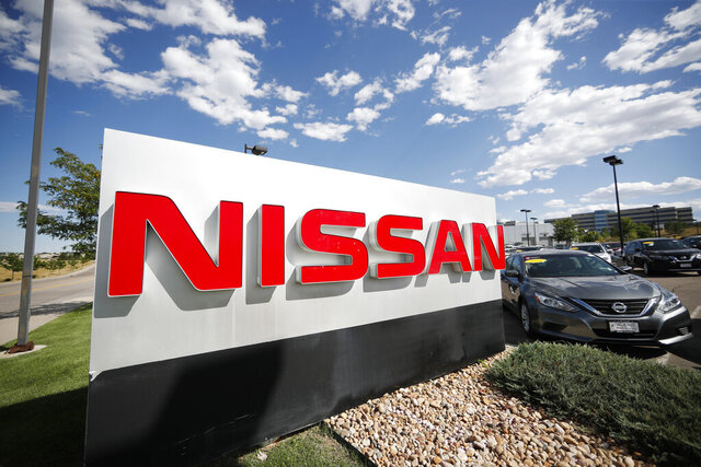 FILE - This Aug. 25, 2019, file photo shows a sign at a Nissan dealership in Highlands Ranch, Colo. Nissan is recalling nearly 346,000 vehicles worldwide to replace dangerous Takata air bag inflators that can explode and hurl shrapnel. (AP Photo/David Zalubowski)