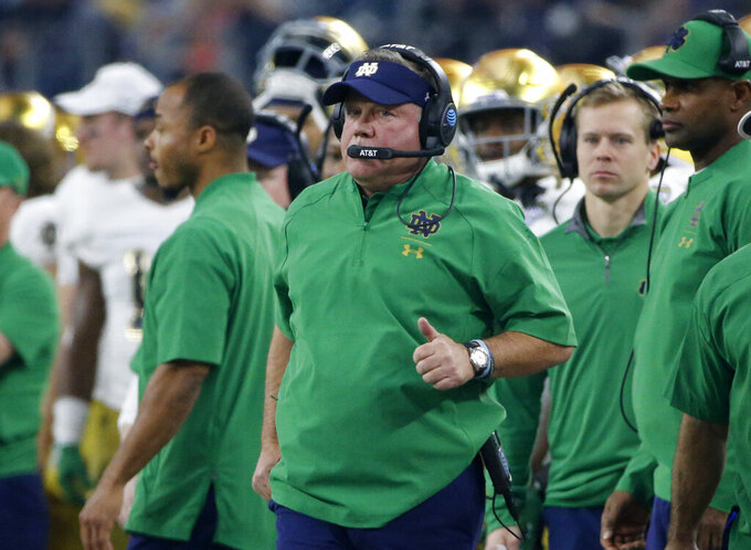 "FILE - In this Saturday, Dec. 29, 2018, file photo, Notre Dame head coach Brian Kelly watches play against Clemson during the NCAA Cotton Bowl football game in Arlington, Texas. Nine practices into spring football practice, Brian Kelly has an idea how his Notre Dame football depth chart is settling in at running back, wide receiver and cornerback. Linebacker is another matter. ""Clark is working overtime,"" Kelly said of defensive coordinator Clark Lea, who oversees the position that graduated its top two inside linebackers in Te'von Coney (123 tackles) and Drue Tranquill (86) (AP Photo/Michael Ainsworth, File)"