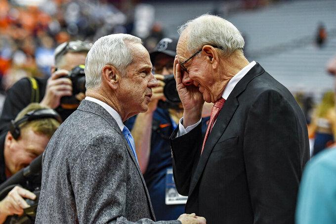 North Carolina head coach Roy Williams, left, talks with Syracuse head coach Jim Boeheim before an NCAA college basketball game in Syracuse, N.Y., Saturday, Feb. 29, 2020. (AP Photo/Adrian Kraus)