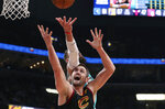 Memphis Grizzlies center Jonas Valanciunas, top, and Cleveland Cavaliers forward Kevin Love reach for a rebound during the first half of an NBA basketball game Friday, Jan. 17, 2020, in Memphis, Tenn. (AP Photo/Karen Pulfer Focht)