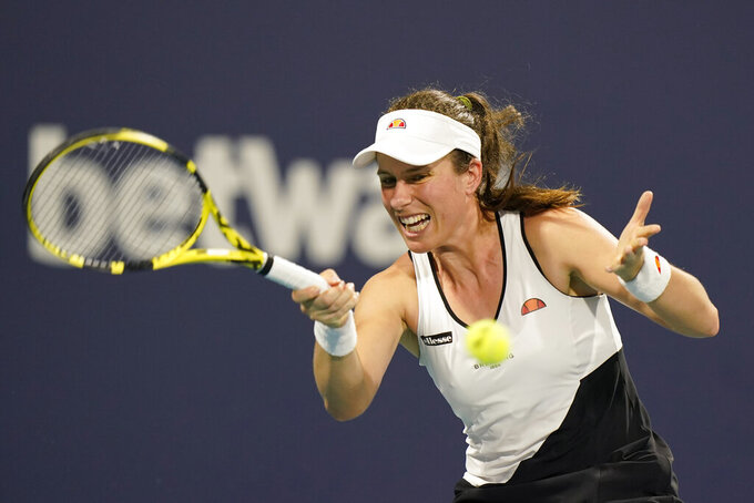 FILE - In this March 27, 2021, file photo, Johanna Konta of Britain, returns to Petra Kvitova of the Czech Republic, during the Miami Open tennis tournament in Miami Gardens, USA.  Johanna Konta won't compete at the Tokyo Olympics after testing positive for COVID-19, she said Tuesday July 13, 2021, two weeks after missing Wimbledon because a member of her team had contracted the coronavirus. (AP Photo/Wilfredo Lee, File)