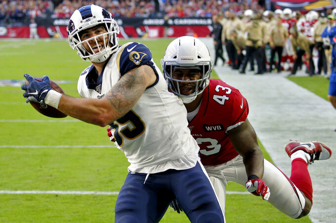 Los Angeles Rams tight end Tyler Higbee pulls in a touchdown as Arizona Cardinals outside linebacker Haason Reddick (43) defends during the first half of an NFL football game, Sunday, Dec. 1, 2019, in Glendale, Ariz. (AP Photo/Ross D. Franklin)