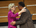 FILE - In this June 29, 2019, file photo, Sen. Elizabeth Warren, D-Mass., embraces the Rev. Jesse Jackson after being introduced during the Rainbow PUSH Coalition International Convention at Apostolic Faith Church in Chicago. Joe Biden, the presumptive Democratic presidential nominee, is under mounting pressure to pick a black woman in the wake of recent outrage over racial injustice and police brutality. But some black leaders say Warren's progressive politics, economic populism and specific policy proposals addressing everything from maternal mortality to the coronavirus could put her in a strong position. (Kevin Tanaka/Chicago Sun-Times via AP, File)