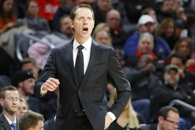 Cincinnati head coach John Brannen directs his players from the bench during the first half of an NCAA college basketball game against Tennessee, Wednesday, Dec. 18, 2019, in Cincinnati. (AP Photo/John Minchillo)