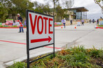 A sign directs people to an early voting poll at the Collin College campus in Wylie, Texas on Thursday, Oct. 29, 2020. (Juan Figueroa/The Dallas Morning News via AP)