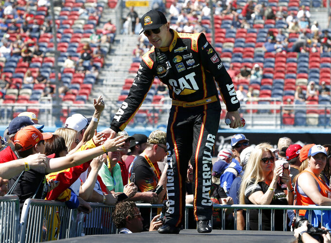 Daniel Hemric is greeted by fans during driver introductions prior to the start of the NASCAR Cup Series auto race at ISM Raceway, Sunday, March 10, 2019, in Avondale, Ariz. (AP Photo/Ralph Freso)