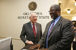 Gene Rainbolt, left, the chairman emeritus of BancFirst Corporation, and Rev. Theodis R. Manning, Sr., right, Senior Pastor, Divine Wisdom Worship Center, smile after delivering an initiative petition to the Oklahoma Secretary of State's office that could lead to the release of hundreds more inmates Tuesday, Nov. 12, 2019, in Oklahoma City. (AP Photo/Sue Ogrocki)