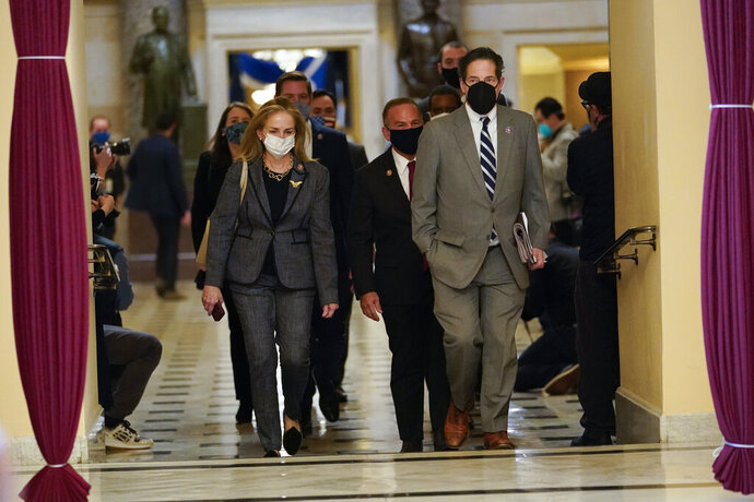 Impeachment managers Rep. Madeleine Dean, D-Pa., and Rep. Jamie Raskin, D-Md., walk to the House chamber on Capitol Hill in Washington, Wednesday, Jan. 13, 2021. (AP Photo/Susan Walsh)