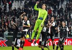 Juventus' goalkeeper Wojciech Szczesny jumps in the air, celebrating with his team after winning the Champions League group D soccer match between Juventus and Atletico Madrid at the Allianz stadium in Turin, Italy, Tuesday, Nov. 26, 2019. (AP Photo/Antonio Calanni)