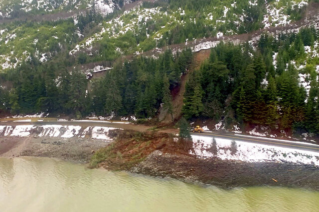 This photo from the U.S. Coast Guard shows where a rainstorm caused landslides in Haines, Alaska, Thursday, Dec. 3, 2020. Authorities have identified the two people missing after a landslide the width of two football fields slammed into the southeast Alaska community. The Coast Guard remains engaged with the Alaska State Troopers and the city of Haines while responding to this event. (Lt. Erick Oredson/U.S. Coast Guard via AP)