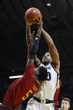Butler's Bryce Nze (10) grabs a rebound against Louisiana Monroe's Tyree White (5) during the first half of an NCAA college basketball game, Saturday, Dec. 28, 2019, in Indianapolis. (AP Photo/Darron Cummings)