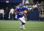New York Giants running back Saquon Barkley (26) finds running room against the Dallas Cowboys in the first half of a NFL football game in Arlington, Texas, Sunday, Sept. 8, 2019. (AP Photo/Michael Ainsworth)