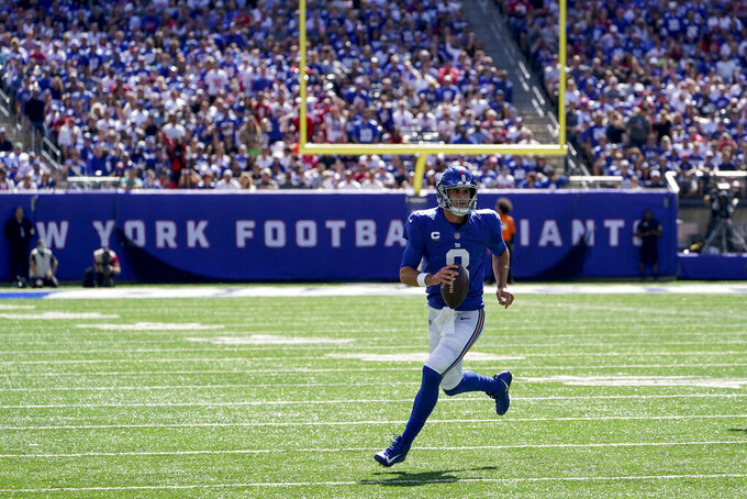 New York Giants quarterback Daniel Jones looks to pass on the run during the first half of an NFL football game against the Atlanta Falcons, Sunday, Sept. 26, 2021, in East Rutherford, N.J. (AP Photo/Seth Wenig)