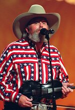"FILE - Singer Charlie Daniels performs in Nashville, Tenn., on May 7, 1992. Daniels, who had a hit with ""Devil Went Down to Georgia"" has died at age 83. A statement from his publicist said the Country Music Hall of Famer died Monday due to a hemorrhagic stroke. (AP Photo)"