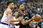 Toronto Raptors forward Norman Powell (24) looks for the shot as New York Knicks forward Kevin Knox (20) covers during first half NBA basketball action in Toronto, Monday, March 18, 2019. (Frank Gunn/The Canadian Press via AP)