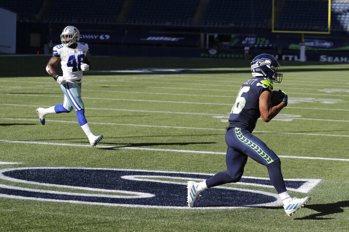 Seattle Seahawks wide receiver Tyler Lockett, right, makes a catch for a touchdown against the Dallas Cowboys during the first half of an NFL football game, Sunday, Sept. 27, 2020, in Seattle. (AP Photo/John Froschauer)