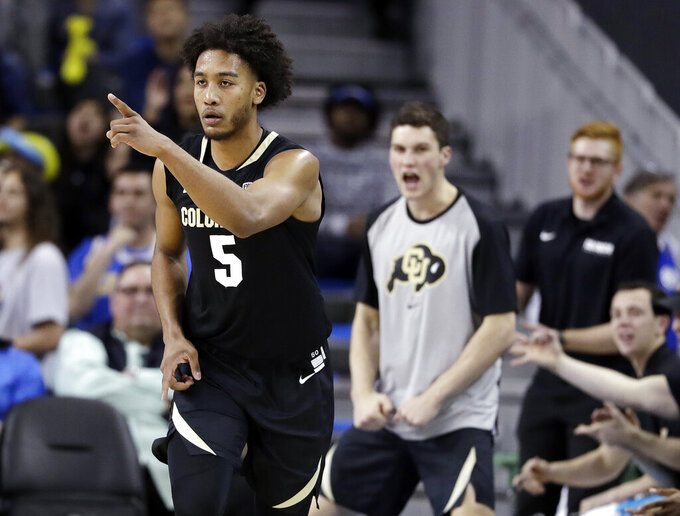 Colorado guard D'Shawn Schwartz (5) gestures after making a 3-point basket against UCLA during the second half of an NCAA college basketball game Wednesday, Feb. 6, 2019, in Los Angeles. (AP Photo/Marcio Jose Sanchez)