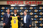 From left, Los Angeles Lakers General Manager Rob Pelinka, left, guard Russell Westbrook, and head coach Frank Vogel pose for a photo at an introductory press conference for Westbrook in Los Angeles, Tuesday, Aug. 10, 2021. (AP Photo/Kyusung Gong)