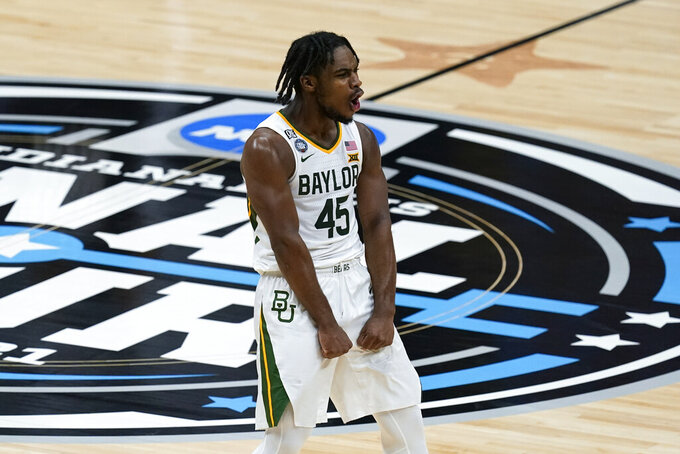 Baylor guard Davion Mitchell (45) celebrates during the first half of a men's Final Four NCAA college basketball tournament semifinal game against Houston, Saturday, April 3, 2021, at Lucas Oil Stadium in Indianapolis. (AP Photo/Darron Cummings)